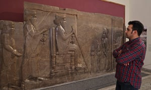 A visitor looks at the ancient central relief of the northern stairs of the Apadana in Persepolis, at the National Museum of Iran in the capital Tehran today.