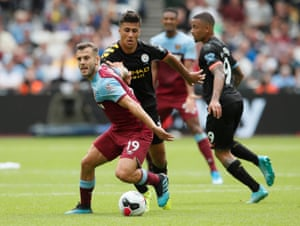 Jack Wilshere holds off Rodri during West Ham's game against Manchester City.
