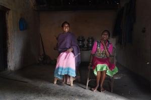 Anita Bai, 15, with her mother, Badri, 40. Anita has a tattoo on her forehead