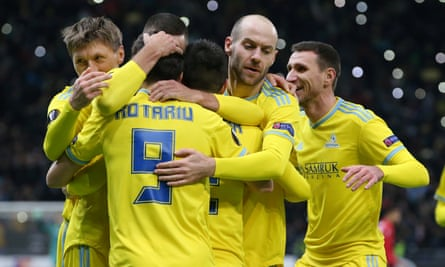 Astana's Dorin Rotariu celebrates with teammates after his side's second goal against Manchester United