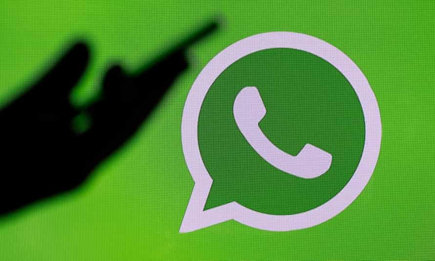 WhatsApp icon next to a silhouette of a phone in a hand