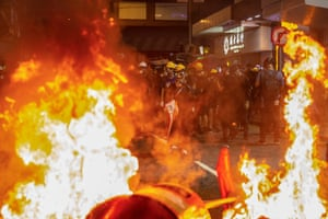 Garbage bins are set on fire by anti-extradition bill protesters during a rally in Causeway Bay.