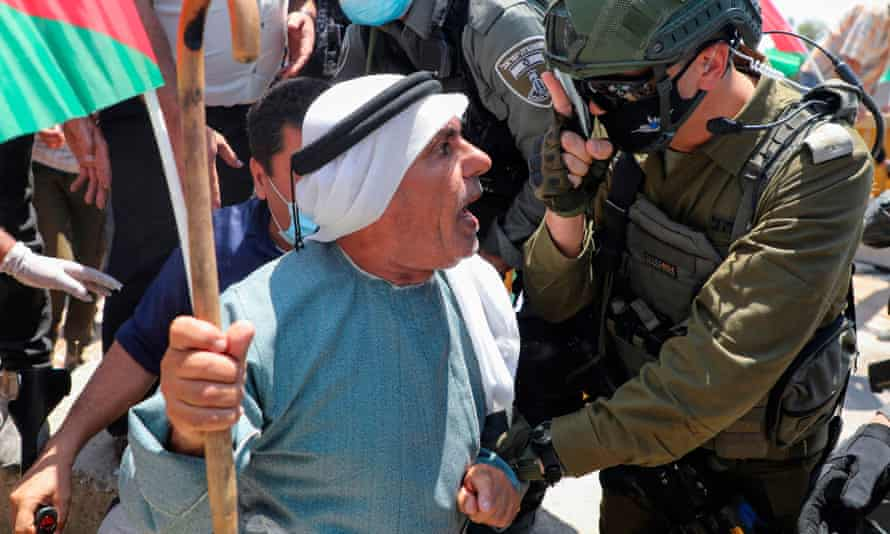'There is a serious argument about injustices to be had'. An Israeli border guard gestures at a Palestinian protester in July 2020.