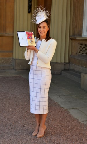 Jessica Ennis-Hill holds her award after she was made a Dame CBE by the Duke of Cambridge