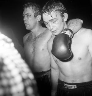 Chris Finnegan (left) puts an arm around Johnny Frankham after beating him on points in their British light heavyweight championship fight in October 1975