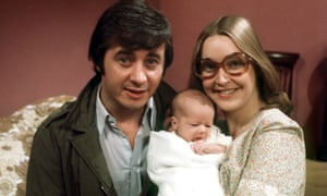 Ray Langton (Neville Buswell) with baby Tracy and Deidre (Anne Kirkbride) on the Coronation Street set in 1977.