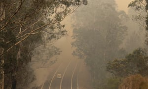 Smoke from wildfires shrouds a road near Moruya