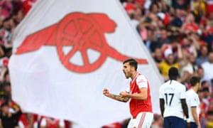 Dani Ceballos celebrates one of Arsenal's goals in the draw with Tottenham. 'I love football here, the way they live and breathe it,' he says.