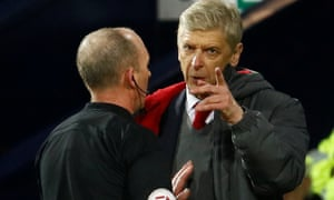 Arsene Wenger remonstrates with referee Mike Dean