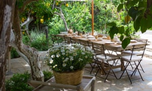 Outdoor breakfast area under the lemon trees at Ktima Lemonies guesthouse, Andros, Greece.