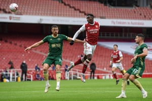 Nketiah heads the ball goalwards