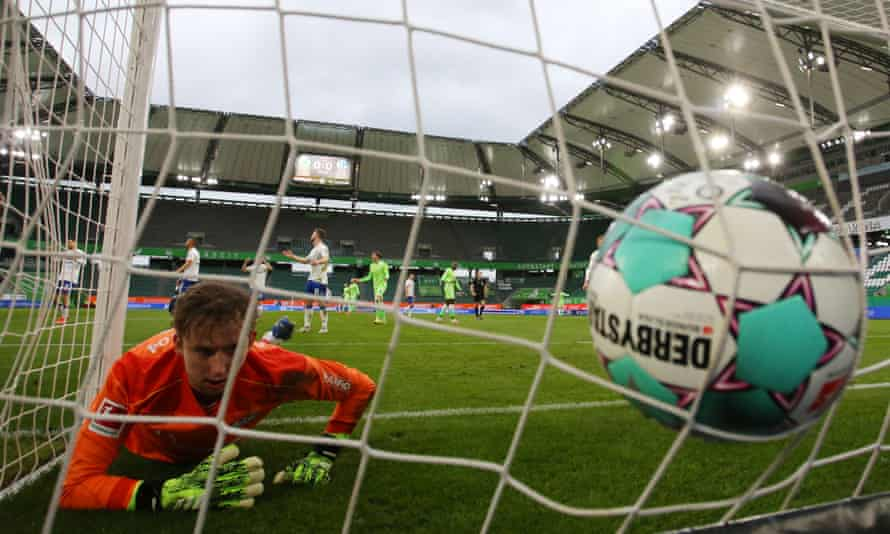 Frederik Rönnow reacts after Shkodran Mustafi's header squeezes past him.