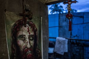 Religious icons in the house of 84-year-old Remy Fernandez