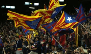 Barcelona fans wave pro-Catalan independence flags during the Champions League match against Bayer Leverkusen.
