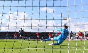 Crewe goalkeeper Dave Richards saves James Hanson's penalty.