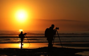 Photographers capturing sunrise