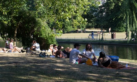 People socialising in a park.