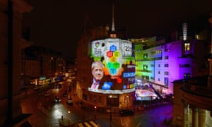 A handout photo made available by the BBC shows exit polls results projected on to Broadcasting House in London.