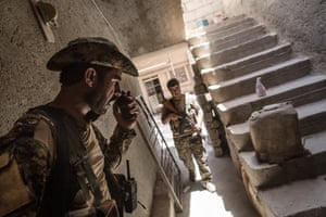 Ali, an Arab YPG soldier, makes a call to manage his fighters on the frontline
