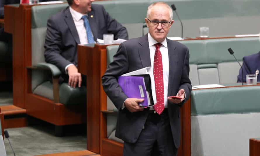 Phone in hand, Malcolm Turnbull arrives for question time in the house of representatives on Wednesday.