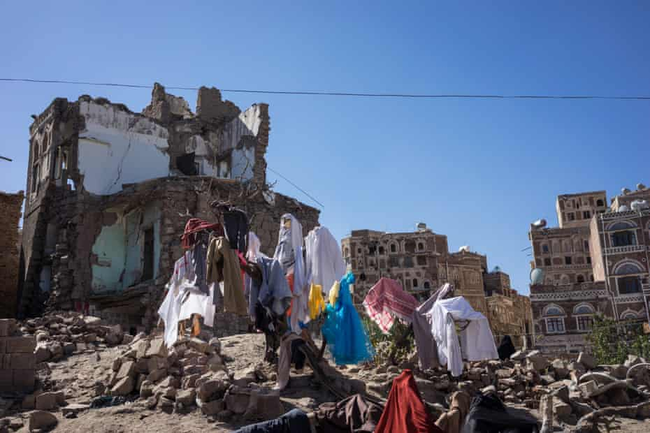 The laundry of the Osba'ah family drys among the ruins of their neighbourhood in Sana'a in December 2016. A Saudi-led bombardment in September 2015 hit the home (left) of the Alini family, claiming the lives of all 10 members including eight children. Dec 20, 2016 - Sana'a, North of Yemen. The effects of the bombardment on the morning of September 19, 2015 by the Saudi-led coalition aircraft in the area of the Al-Falhi area of the Unesco World Heritage site, as part of the old city of Sana'a, were the result of the bombardment of the home of the vegetable seller, Where he spent his life with his wife and their eight children: Mary and Maram, twins; 13; Malal 7; Nasim 12, and Mohammed 8; Ahmed, 18; Ali is 7 years old and Yahya is 5 years old.