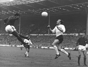 Portugal's Eusébio heads towards Stiles during the World Cup semi-final at Wembley on 26 July 1966