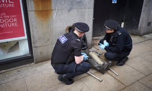 Police officers in Manchester assist a man who is thought have taken spice.