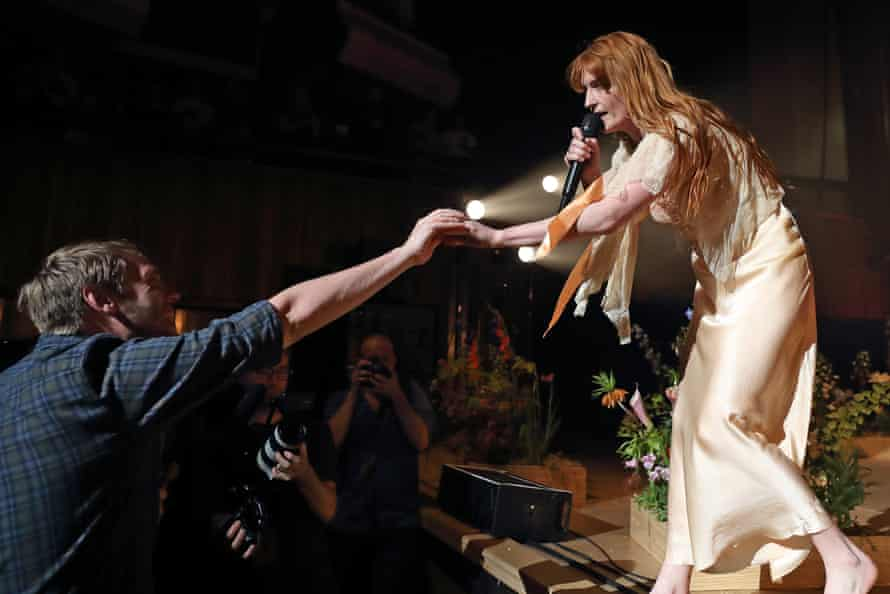 Florence Welch with a fan.
