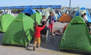 Children play near Piraeus harbour.