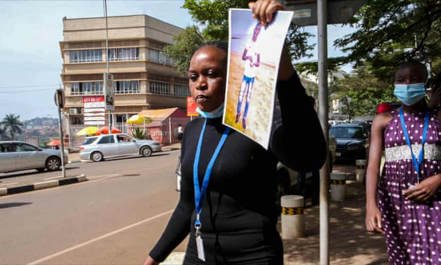 Hajarah Nikitto holds up a picture of her dead son, Amos Ssegaw