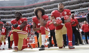San Francisco 49ers players Eli Harold, Colin Kaepernick and Eric Reid kneel during the national anthem