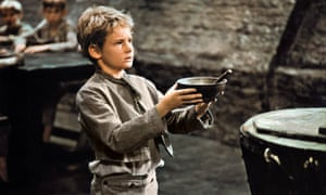 'Please, sir, I want some more.' Mark Lester as Oliver Twist in Oliver! (1968).