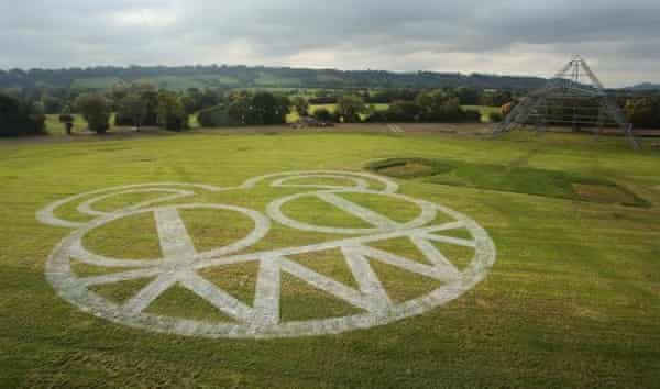 Radiohead's 'demonic bear face' logo painted in the grass at Worthy Farm, announcing their 2017 Glastonbury headline slot.