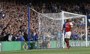 Arsenal's Pierre-Emerick Aubameyang reacts after spooning the ball over the bar.