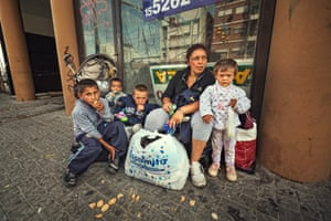 Karina in the street with four children