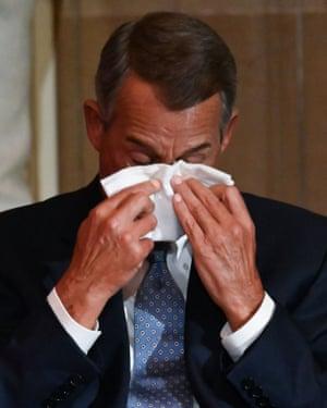 John Boehner wipes his eyes.