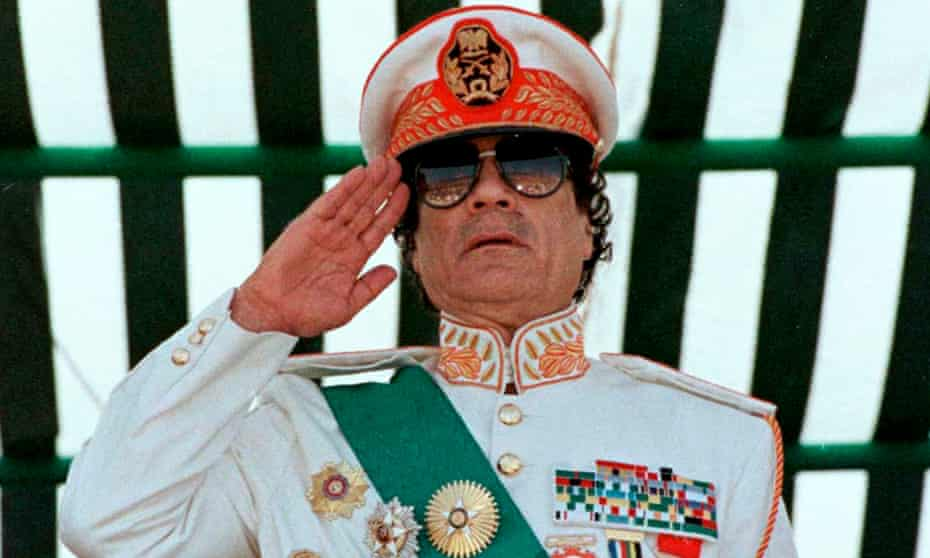 Muammar Gaddafi saluting his armed forces during a parade in Tripoli, 1999.