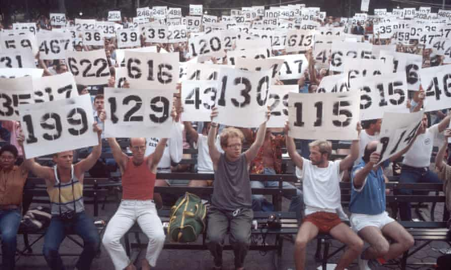 People hold up signs representing the numbers of Aids patients in a demonstration in support in Central Park, New York, 8 August 1983.