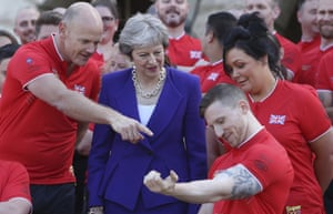 London, England Prime Minister Theresa May speaks with athletes