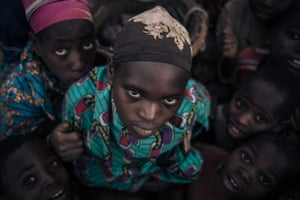 Displaced girls and boys from the Bafuliru community pose for a photograph in the internally displaced persons (IDP) camp in South Kivu province, Bijombo, Democratic Republic of the Congo