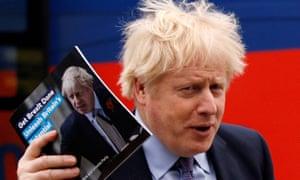 Boris Johnson holds a copy of the Conservative 2019 manifesto