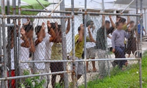 Asylum-seekers look through a fence at the Manus Island detention centre in Papua New Guinea March 21, 2014. Faces pixellated at source. Picture taken March 21, 2014.      Eoin Blackwell/AAP/via REUTERS     ATTENTION EDITORS - THIS PICTURE WAS PROVIDED BY A THIRD PARTY. EDITORIAL USE ONLY. NO RESALES. NO ARCHIVE. AUSTRALIA OUT. NEW ZEALAND OUT