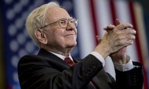 Warren Buffett applauds at a rally for Democratic presidential candidate Hillary Clinton in Omaha, Nebraska.