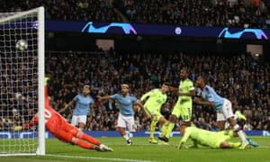 Manchester City's Raheem Sterling scores their first goal.