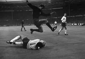 Mexico's Ramiro Navarro of Mexico leaps over Gordon Banks during England's 2-0 win in their second first phase game in the 1966 World Cup