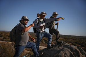 Jesse and Alfredo Barajas, two of the victim's brothers, and his son, José, search an area near his ranch last month. José Barajas was dragged from his home near the town of Tecate on 8 April, 2019 and has not been seen since.
