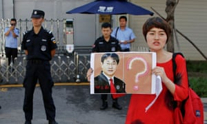 Li Wenzu, wife of detained lawyer Wang Quanzhang, protests in Beijing.