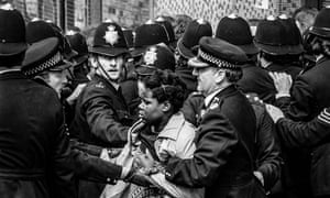A woman is moved away from the trouble