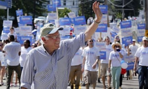 Bernie Sanders marches with supporters in the Labor Day parade on Monday in Milford, New Hampshire.