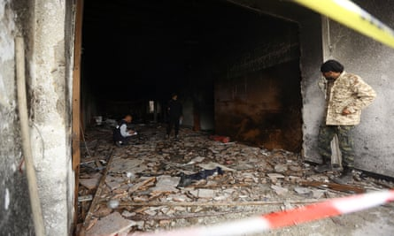 The headquarters of Libya's elections commission in Tripoli after an attack by suicide bombers.